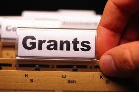 "Image - Grants (shown as a file in a filing cabinet labeled ""Grants"")"